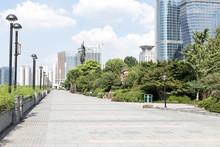 Empty Sidewalk Near Modern Building