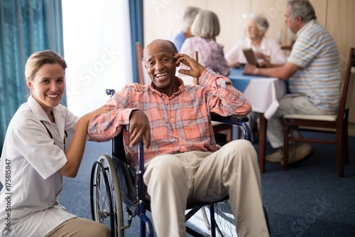 Fotografia, Obraz  Portrait of cheerful disabled senior man sitting on wheelchair