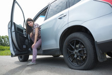 Woman With Car Broken Down, Flat Tire