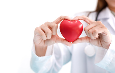 Close up of female doctor with red heart. Medical and Healthcare concept