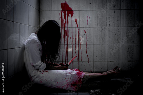 Photo  Ghost woman or zombie holding knife for kill yourself with blood violence in house of ruin, nightmare, horror of scary fear on hell is monster devil in halloween festival
