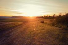 Haystack On Farmland With Clou...