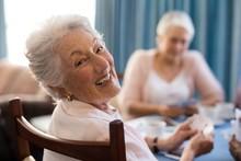 Smiling Senior Woman Playing C...