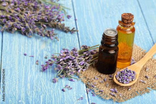 Fototapeta Herbal oil and lavender flowers on wooden background obraz