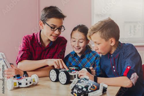 Fotografie, Obraz  Stem education. Kids creating robots at school
