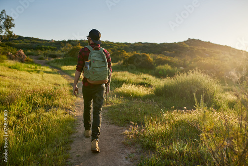 male millennial hiker walking trail in california during sunset Wallpaper Mural
