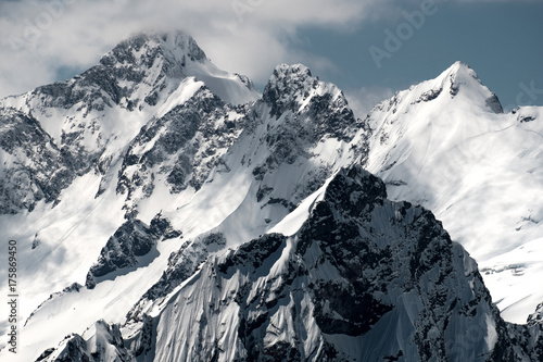 Inaccessible snow-capped peaks closeup Canvas-taulu