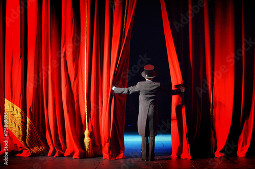the actor in a tuxedo opens the theater curtain Canvas Print