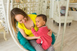 Loving Mother Holding Mixed Race Baby Son At Home