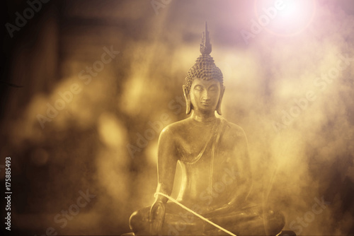 Tuinposter Boeddha The old Buddha Statue in Classic Tone and smoke or fog