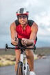 Professional cyclist biking on road bike training for triathlon competition on road bicycle in Hawaii. Triathlete working out outdoors. Man sport athlete.