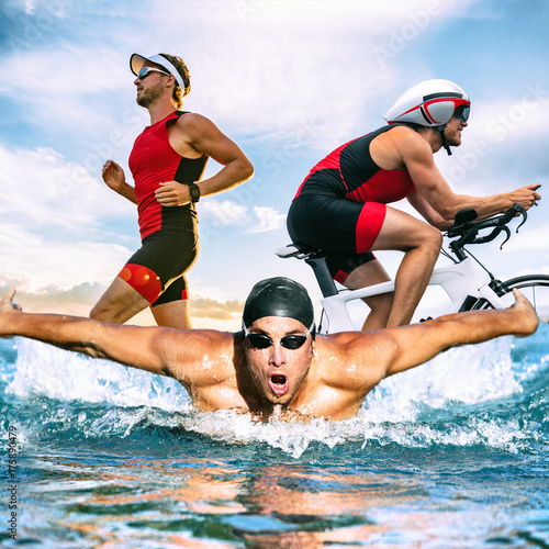 Triathlon swim bike run triathlete man training for ironman race concept Wallpaper Mural