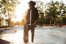 Young African Man Skateboarder...