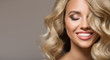 Leinwanddruck Bild - Blonde woman with curly beautiful hair smiling on gray background.