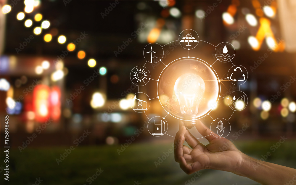 Fototapety, obrazy: Hand holding light bulb in front of global, show the world's consumption with icons energy sources for renewable, Ecology concept. Elements of this image furnished by NASA.