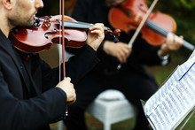 Man In Black Suit Plays The Violin