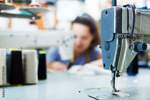 Láminas  Sewing machine on factory, closeup