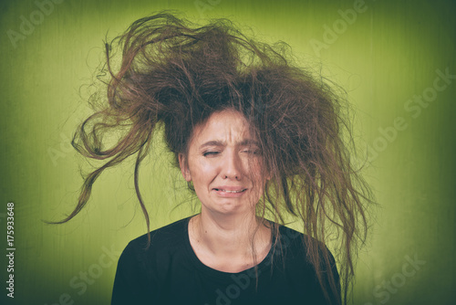 angry woman with a strange hair style