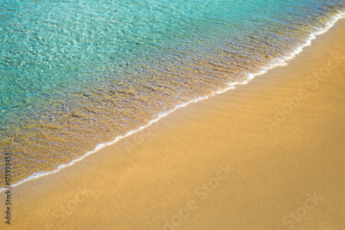 Sand beach water edge summer background.