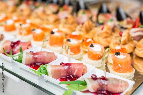 Gourmet appetizers: caviar, venison, tuna and salmon. Canvas Print
