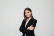 canvas print picture - Portrait of smiling young businesswoman in suit