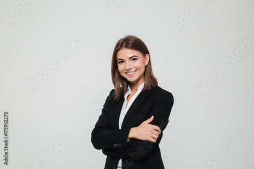 Portrait of smiling young businesswoman in suit