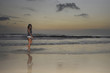 attractive african american black woman walking on sunset beach