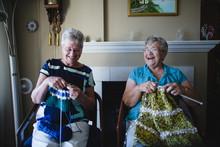 Two Senior Women Knitting Toge...