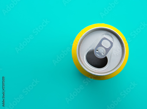 Top view of drink can with drops on mint green