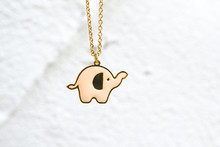 Elephant Pendant Amulet. Closed Up Details Of A Cute Pink Elephant Pendant Charm Bracelet.