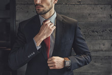 Stylish Man With A Red Tie