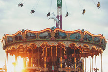 A Merry Go Round At Sunset