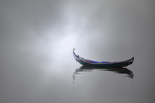 Boat In A Foggy Morning