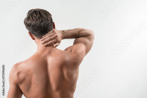 Photo Charming sexual man is suffering from ache