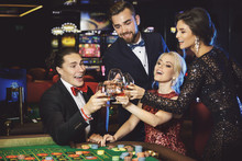 People Celebrating Their Win After Successful Game In The Casino