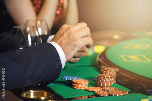 Male hands and casino chips плакат
