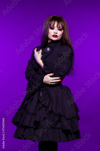 Witch A Vampire In A Black Gothic Dress On A Purple Background