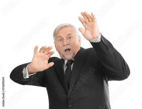 Fotografía  Scared elderly man on white background