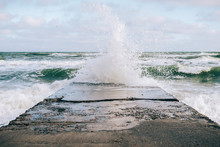 Sea Wave Breaking On The Pier