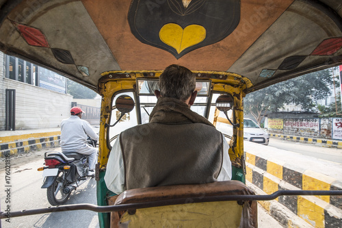 Fotografie, Obraz  A rickshaw (also known as Tuc Tuc) driver is driving in the streets of Agra in India