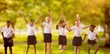 Composite image of full length of students in school uniforms
