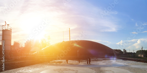 Biogas plant technology at sunset which is the renewable energy technology Canvas Print