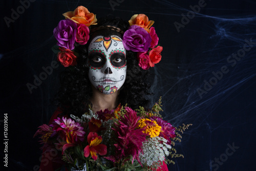 La Calavera Catrina little girl costume and makeup. Día de los Muertos celebration