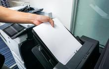 Close Up Man Put Paper Sheet Into Office Printer Tray
