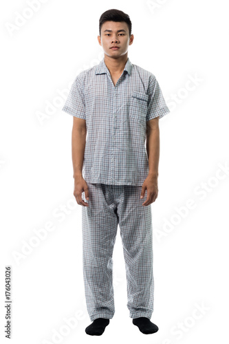 3ac9bebffc Handsome man in pajamas close up portrait studio on white background ...