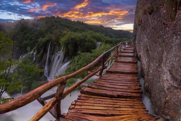 Fototapeta samoprzylepna foggy and multicolored dawn over beautiful waterfalls in the park of plitvice lakes in croatia