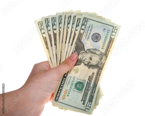 Photo  Young female hand holding stack of twenty dollar bills fanned out isolated on white background