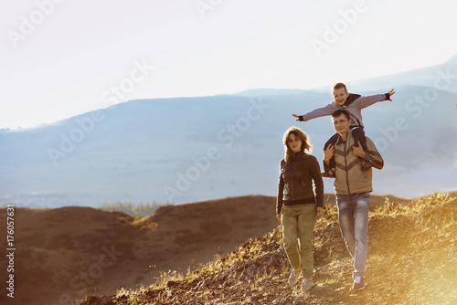 Happy family walking nature mountains area