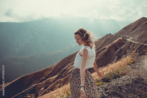 Fotografía  Romantic free young woman with hair wind enjoy harmony with nature and fresh air