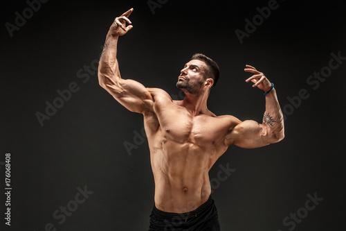 Vászonkép Very brawny guy bodybuilder posing